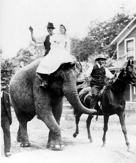 Joe and Myra Keaton, parents of movie comedian Buster Keaton, ride on an elephant.